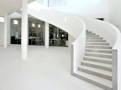total white showroom - #concrete #microtopping staircase http://www.idealwork.com/Micro-Topping-Features-and-benefits.html