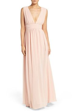 Free shipping and returns on Lulus Plunging V-Neck Chiffon Gown at Nordstrom.com. Plunging necklines and deep arm openings style the captivating bodice of a lushly gathered chiffon gown. A wide Empire waist slims and elongates the figure, while a high side slit punctuates the sweeping A-line skirt.