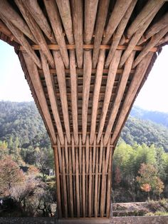 an ancient wooden bridge in hangzhou city, china that inspired pritzker prize-winning architect wang shu for his museum in the city.