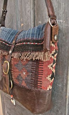 The Buffalo bag messenger bag. Vintage kilim, Hmong indigo, bridle leather and old coins. Fully lined with African mud cloth. www.kajeoneworld.com