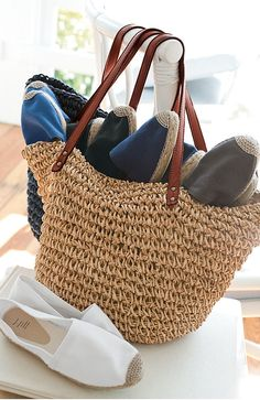 A basket of espadrilles and flip-flops by the door....
