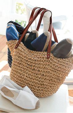 A basket of espadrilles and flip-flops by the door....