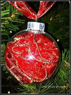 add some ribbon to a clear ball and u have a beautiful ornament to add to your tree