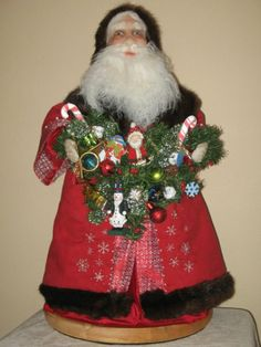 Regal Red Santa with hand embroidery and mink trims.