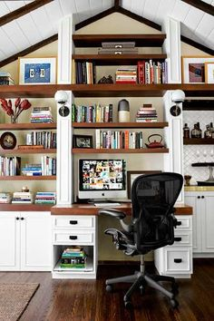 Floor-to-ceiling mahogany shelves add plenty of storage and visual display for this home office. | Photo Joe Schmelzer | thisoldhouse.com