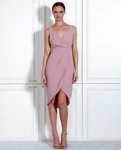 Lola Dress. A gorgeous cocktail length dress designed by Leah Da Gloria for White Runway. A timeless v-neck style featuring a flattering draped over-lay skirt.