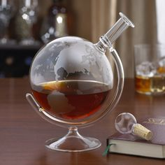 """A real conversation piece for the spirits lover in your life. The lovely globe decanter is beautiful and unique. It spins on it's stand and it's a gift that's """"worldly"""" enough for all spirits enthusiasts. This lead free decanter is fragile and recommended to be hand washed. Dimensions: 9 x 7 inches Weight: 1.8 pounds #bourbonandboots"""