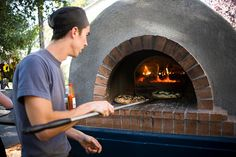 Brick oven wood fired pizza at our wedding reception care of Kashaya Adams and her amazing team. Photo by Jay Reilly, pizza by Kashaya's Brick Oven Pizza Stone Pizza Oven, Diy Pizza Oven, Pizza Oven Outdoor, Outdoor Cooking, Pizza Ovens, Wood Burning Oven, Wood Fired Oven, Foyers, Outdoor Kitchen Patio