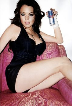 Lindsay Lohan looks better with dark hair... And when red bull was the way she used to get a buzz.