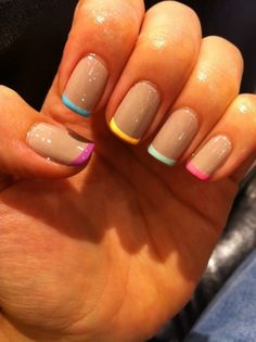 This could be sooo cute if someone had a wedding multi-colored wedding or something.. oh, man,, imagine how the color would POP on black matte polish!!  French rainbow tips - a subtle way to have some fun with your polish