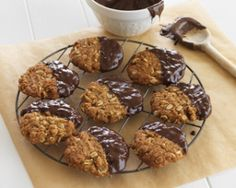 Choc Dipped Anzac Biscuits    1 cup rolled oats   3/4 cup dessicated coconut   1 cup flour   3/4 cup soft brown sugar   125g butter   2 Tbsp golden syrup   1/2 tsp baking soda   2 Tbsp boiling water   200g dark chocolate, melted