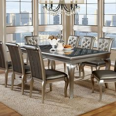 Glass Dining Room Tables: Choose the dining room table design that defines your family's style and character. Free Shipping on orders over $45!
