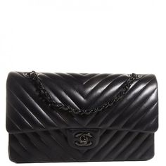 This is an authentic CHANEL Lambskin Chevron Medium Double Flap in So Black NEW. This stylish shoulder bag is crafted of chevron-quilted luxurious lambskin leather.
