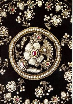 Ruby, pearl, silver, gold and silk velvet embroidery.