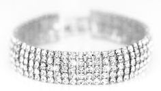 18K White Gold-Plated Swarovski Elements Pave Bracelet Dazzle the night away with the Swarovski Elements Pave Bracelet      Features real Swarovski elements      A stunning piece which will go with all of your favourite evening looks      Handcrafted in the UK      Gold plated bracelet measures 55-60mm      Great for jazzing up a simple outfit      Save 81% on the Swarovski Elements Pave...
