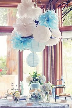 This classic rustic French-inspired boy baby shower is incredible. Blue macarons and feathers abound.