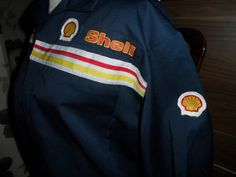 I imagine Nazeer in his uniform for the gas station, very similar to this one.