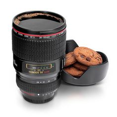 Coffee cup that looks and feels like a camera objective. The lid works as a cookie plate. -  great gift idea