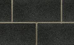 Profile Series Block in Absolute Black Quartz by Brampton Brick. The compressive strength of Profile Series concrete block units is suitable for use in a masonry-bearing or single wall. This product is also manufactured with a water repellent additive and is permeable to water vapor. Concrete Masonry Unit, Concrete Blocks, Smooth Face, Black Quartz, Brick, Profile, The Unit, Water