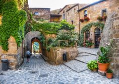 Picture of Beautiful view of idyllic alley way in famous Civita di Bagnoregio near Tiber river valley, Lazio, Italy stock photo, images and stock photography. Festival Medieval, Places In Italy, Places To Visit, Rent A Villa, Day Trips From Rome, Italian Village, 10 Picture, We Are The World, Provence