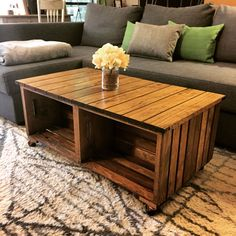 Our DIY wood crate coffee table! How we did it: We used 4 wood crates from a craft store and some good 1x4s from the hardware store. First we removed the slats from one side of each crate. Then we cut them down to fit the end of the crate so when we turned it sideways, theyd be vertical on the ends of the assembled table. Cut the 1x4s for the top stained everything. Lastly, we assembled with some copper and black casters. Best tips: measure twice, cut once, and assemble on a hard flat…