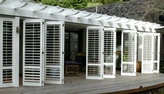 bifold shutters on porch Shutters Exterior, Outdoor Shutters, Interior Shutters, Rustic Shutters, Porch Enclosures, Window Design, Modern Interior Design, Porch, Shutters Repurposed Decor
