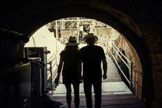 Gilmour and Samson head to the stage, down one of the tunnels which would last have been used by performing gladiators.