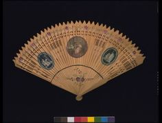 Sandlewood brisé fan with applied paper medallions, English c1800. V&A