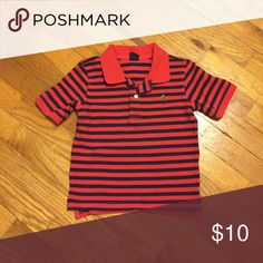 Gap striped polo shirt. Size 4. Gap kids red and navy striped polo shirt. Excellent used condition. No stains, rips, tears, etc. Size 4. Pairs nicely with jeans, khakis, and even navy/black pants or shorts. GAP Shirts & Tops Polos