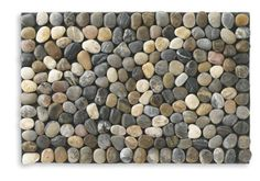 The mat is assembled from Naturally smooth river rocks offer durability and organic beauty in our Zen-inspired floor mat. Description from oormats.net. I searched for this on bing.com/images