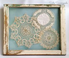 Have an heirloom doily collection from grandma? They're easy to display by stitching them to window screen that has been attached to a salvaged window.