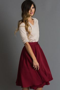 I love knee length dresses and skirts, especially A line. I like the chic, slim look of the top with the flowing/puffy skirt. Tucking in blouse like this is fine for work, but I would not want to do that every day.
