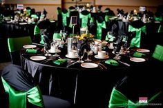 The tables and chair covers were black with Emerald green sashes tied in a flip knot.  It matched the bridesmaids dresses perfectly and made the room look so classy!