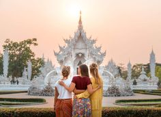 Three girls share the golden hour light prior to sunset in front of the White Temple in Chiang Rai, Thailand. Chiang Mai, Singapore Sights, Places Around The World, Around The Worlds, Stuff To Do, Things To Do, White Temple, Cities In Italy, Northern Thailand