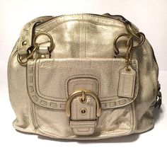 Rare Coach Gold Leather bag Like new, worn maybe twice stunning metallic gold Coach leather handbag. Full grain cowhide leather. Brown coach monogram satin interior, with one large zippered pocket and two smaller open pockets. Large front snap pocket as seen in pic. Coach Bags Shoulder Bags