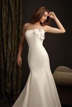 Feel like a Hollywood starlet in this Allure gown for only $584.96. This fit and flare taffeta gown is white size 10.