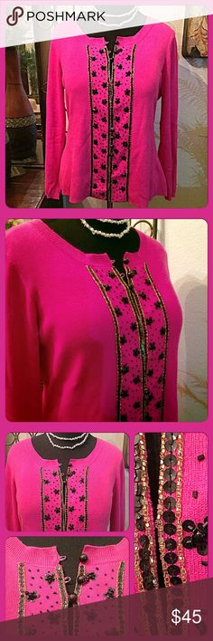 """Loulou de la Falaise Sequin Sweater Gorgeous vivid pink long sleeved sweater to wear for the holidays or anytime. Round neck with center hook & eye and black button closures down the center. Black & gold beads & sequins add that sparkly touch. Great with black pants. The late Loulou de la Falaise was a muse of the late great Yves Saint Laurent. Measurements: Bust=40"""", Shoulder width seam to seam=17"""", Length from shoulder=24"""". Size L. TTS, In excellent condition. Lowballs! Loulou de la…"""