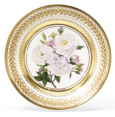 A Russian porcelain plate, Yusupov Manufactory, Arkhangelskoe, 1826 the cavetto painted with blossoming pale pink roses on a leafy branch surrounded by buds after Pierre-Joseph Redouté, the border with a continuous stylized foliate wreath, inscribed in gilt letters Rosier de Philippe Noisette at the base of the cavetto and on the reverse, also in gilt letters, Archangelski 1826 and