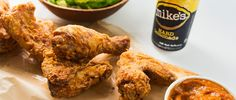 Jose Mendin of Miami's Pubbelly brings Korean flavor to the classic fried chicken. He adds gochujang, a spicy Korean chile paste, to his buttermilk brine, then fries the chicken until it's crisp and golden brown. Drink Mike's Hard Lemonade as a refreshing break between bites of this spicy dish.