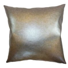"""Faux leather pillow with a metallic finish and feather-down fill. Made in Boston, Massachusetts.  Product: PillowConstruction Material: Faux leather cover and 95/5 feather-down fillColor: MetallicFeatures:  Insert includedHidden zipper closureMade in Boston Dimensions: 18"""" x 18""""Cleaning and Care: Spot clean"""