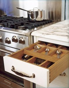 Cutlery drawer w/ sliding upper layer; Christopher Peacock