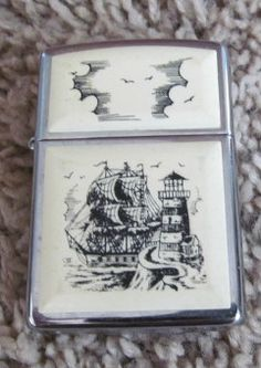 Chrome Zippo Lighter Scrimshaw Lighthouse and Boat $Sold Out