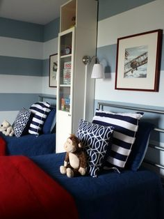 For logans room?  red white and blue boys bedroom with horizontal stripe wall.