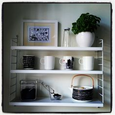 String pocket shelf and marimekko oiva table ware in the kitchen
