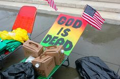 """""""God is dead"""" sign at the Supreme Court"""