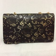Black and gold purse Length: 10.5, Width: 4 inch, Height: 6 inch, Drop: 10.5 inch. - A small scuff on the front black leather beside the magnet that closes the purse (photo #3). - Few gray spots (photo #4) that I've no idea how they got there since the purse is brand new and was never used. - Both imperfections are hard to be noticed except by someone who knows they are there. - faux leather. - more photos are available in a separate listing, please make sure to see all pictures before you…