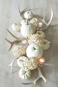 antler and white pumpkin center table piece