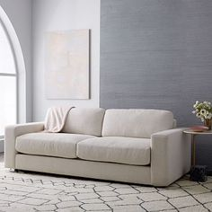 "Urban Sofa (84.5"") #westelmDETAILED SPECIFICATIONS   Overall dimensions: 84.5""w x 39""d x 31""h. Interior seat width: 68"". Seat depth: 23"". Seat height: 19"". Back height: 27.5"". Diagonal depth: 31"". Clearance: 2"". Removable legs."