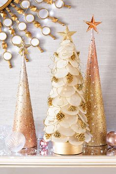 Pier 1's handcrafted tabletop Capiz Tree features pearlescent capiz shells that bring the sparkle you need for our Champagne Shimmer look. Pop open a bottle of bubbly and toast to a season with plenty of shimmer and shine. Here's to dazzling decorations you can celebrate into the new year.
