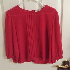Red blouse In excellent condition, cute pattern down front and back is button up, quarter sleeve with buttons to tighten sleeves. Very light weight, 100% polyester Forever 21 Tops Blouses